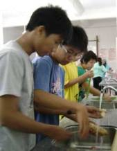 boys washing potatoes