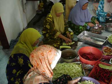 Malay women preparing food