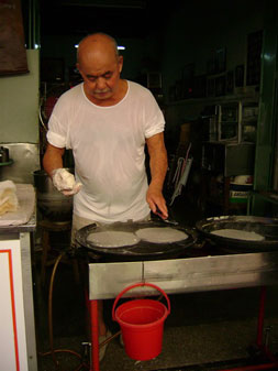 this man makes spring roll skins by hand!