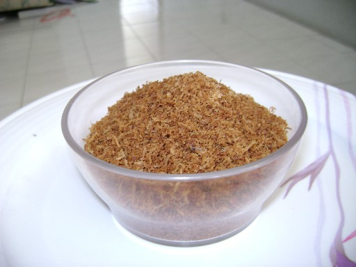 A bowl of toasted coconut